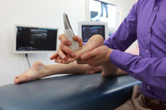 Ultrasound of girl`s foot - diagnosis. Close up stock images