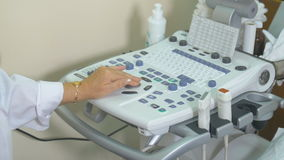 Ultrasound modern equipment. Female unrecognizable doctor operating ultrasonic, ultrasound test unit. stock video