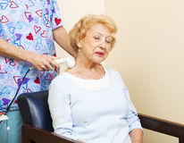 Ultrasound for Neck Pain. Senior chiropractic patient gets ultrasound therapy for her neck pain Royalty Free Stock Photo