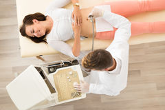 Ultrasound Scan Of The Women`s Abdomen Stock Image