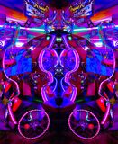 Ultraviolet Arcade Game in Psychedelic Light. Ultraviolet Amusement Arcade Game in Neon Psychedelic Light Montage Mirror Image with other colors Stock Photo