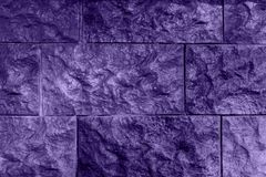 Ultraviolet background, wall from relief brick. Unusual texture royalty free stock photography