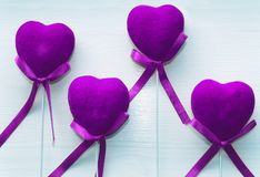 Ultraviolet hearts on white wooden background Stock Photos