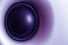 Ultraviolet toned audio speaker or subwoofer dynamic, abstract tech background in ultra violet royalty free stock photos