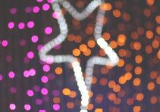 Ultraviolette und orange Farbe des Bokeh-Stern-Lichtes Lizenzfreie Stockbilder