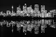 Sydney City Lights by night with reflections in the water royalty free stock image