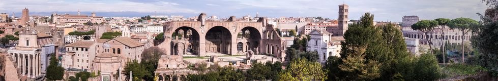 An view of the Antoninus and Faustina Temple, Temple of Romulus, Basilica of Maxentius, Basilica de Francesca Romana and Colosseim stock photo