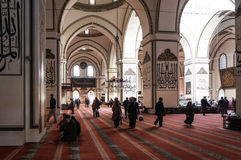 Ulucami, Bursa, Turkey. Bursa, Turkey - Interior view of Ulucami or the Great Mosque in Bursa with people praying and islamic style antique decoration Stock Photos