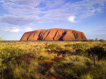 Uluru (Ayers Rock). Uluru early in the afternoon as the sun turns it bright red