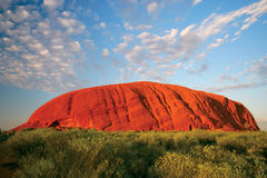 Uluru (Ayers Rock). Uluru early in the morning as the sun turns it bright red stock photography