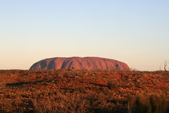 Uluru - Ayers Rock. Uluru also known as Ayers Rock, is one of Australia's most recognisable icons. It is a large sandstone rock formation in the southern part of Stock Images
