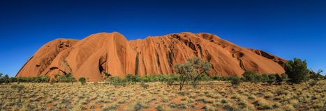 Panoramic view on Uluru, or Ayers Rock, a massive sandstone monolith in the heart of the Northern Territory, Australia. Uluru, or Ayers Rock, is a massive royalty free stock image