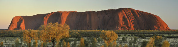 Uluru mountain at sunrise. Panoramic view of Uluru mountain, Ayers Rock (Central Australia), at sunrise royalty free stock image