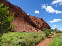 Uluru, Northern Territory, Australia 02/22/18. Base walk trail. Uluru, Northern Territory, Australia 02/22/18. View of the contours and ridges in the side of the royalty free stock photo