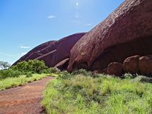Uluru, Northern Territory, Australia 02/22/18. View of the contours and holes in the side of the rock from the Base Walk trail royalty free stock images