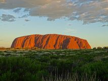 View of Uluru from the sunset viewing area. Uluru, Northern Territory, Australia 02/22/18. View of the ever changing colours of Uluru at sunset from a designated royalty free stock photos