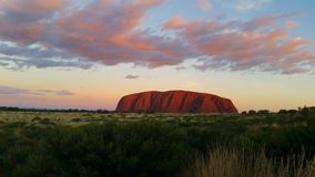 Uluru, Northern Territory, Australia 02/22/18. View of the ever changing colours of Uluru at sunset from a designated viewing. Uluru, Northern Territory royalty free stock photography