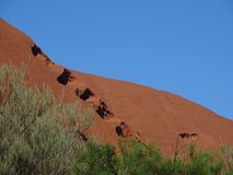View of huge holes in the rock. Uluru, Northern Territory, Australia 02/22/18. View of huge holes in the rock taken from the base walk trail stock photo