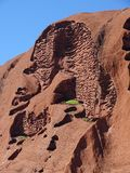 Uluru, Northern Territory, Australia 02/22/18. View of the textures and holes down the side of the rock stock images