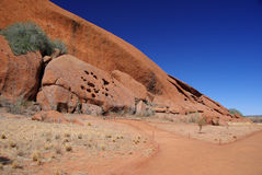 Uluru Rock Formations. A corner of Australia's famous monolith, Uluru (Ayers Rock), showing the interesting formations in the rock face. Uluru – Kata Tjuta Royalty Free Stock Photo