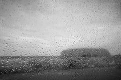 Uluru Through A Wet Window Stock Photos