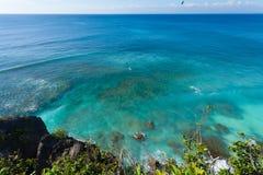 UluWatu. Coastline with beaautiful rocky cliffs and turquoise wavey sea Royalty Free Stock Photography