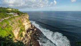 Uluwatu cliff. BALI, INDONESIA - 19TH JUNE 2015; A scenic Uluwatu cliff with pavilion and blue sea in Bali, Indonesia Stock Photos