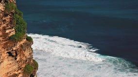 Uluwatu cliff loop. A fragment of rock and big waves of the sea loop stock footage