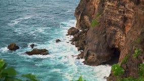 Uluwatu stone cliffs, ocean waves. Aerial top view. Bali, Indonesia. Uluwatu stone cliffs, ocean waves and oceanscape. Aerial top view. Bali, Indonesia stock video footage