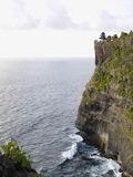 Uluwatu Temple in Bali. A well-known temple on the cliff next to the sea Stock Photos