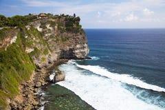Uluwatu Temple and Cliff, Uluwatu, Bali, Indonesia. Image of the hindu Uluwatu Temple and cliffs at Uluwatu, Bali, Indonesia Royalty Free Stock Photos