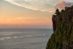 Uluwatu temple at dusk, Bali Stock Images