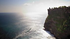 Uluwatu temple loop. Uluwatu temple on the edge of the rocky shore and the boundless sea loop stock video