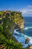 Beautiful Uluwatu Temple perched on top of a cliff in Bali, Indo Royalty Free Stock Photo