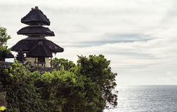 Uluwatu Temple, standing on a rock. Ocean stock photos