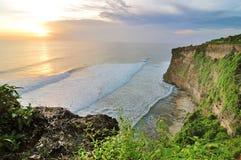 Uluwatu temple at sunset time on Bali island in Indonesia Stock Photos