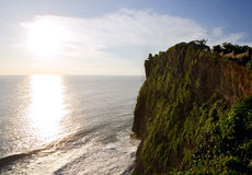 Uluwatu Temple on top of cliffs during Sunset Royalty Free Stock Image