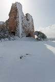 Uluzzo tower after a exceptional snowfall Stock Photos