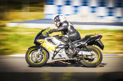 Ulyanovsk, Russia - August 19, 2017. A motorcycle racer with a backpack trains on a motorcycle at a carting track Stock Photo