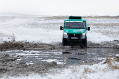 4WD rally truck overcomes a half-frozen pond Stock Images