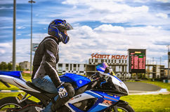 Ulyanovsk, Russia - June 10, 2017. A motorcycle racer on a blue motorcycle finished training on a sports track. Stock Photos