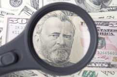 Ulysses Grant on a fifty dollar over heap of dollars United Sta Stock Photography