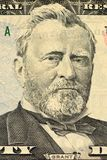 Ulysses S. Grant face on US fifty or 50 dollars bill macro. United states money closeup. Heap of 50 hundred dollar bills on money background royalty free stock photos
