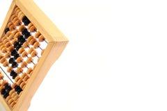 Um ábaco matemático velho em um fundo branco Fotos de Stock Royalty Free