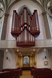 Um órgão em uma igreja Imagens de Stock Royalty Free
