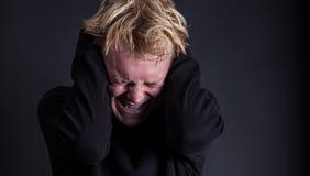Um adolescente masculino agravado fotografia de stock