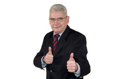 Um alto directivo caucasiano que levanta com polegares acima Foto de Stock