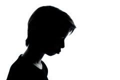 Um amuar temperamental da silhueta do adolescente triste Fotografia de Stock Royalty Free