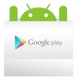 Um android aparece do saco do jogo de Google Imagem de Stock Royalty Free