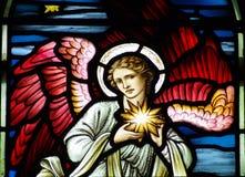 Um anjo com a estrela de Bethlehem Fotografia de Stock